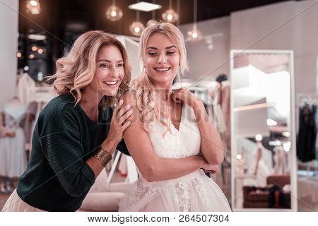 Nice Pleasant Mother And Daughter Being In The Wedding Boutique