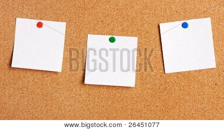 Sticky note hanging on cork-board