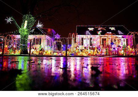 Shiny Christmas Decorations And Lights At Night. Glow Christmas Display Outside