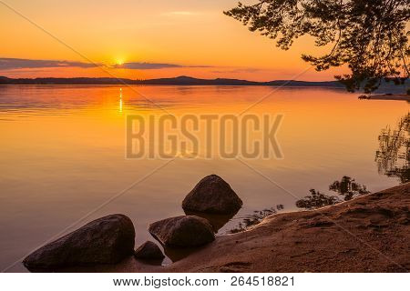 Colorful Sunset And Reflections From Calm Water