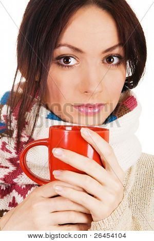 Young beautiful woman in warm scarf with a cup of tea