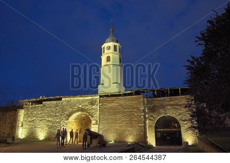 BELGRADE, SERBIA - JULY 19, 2018: Clock Tower and Stambol Gate in Kalemegdan Fortress at night