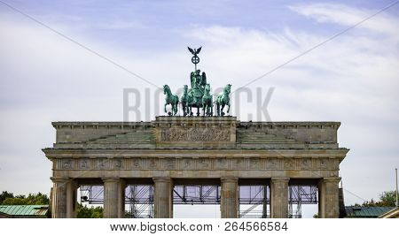 Brandenburg Gate In Berlin. Famous destination in Germany. Cloudy sky background.