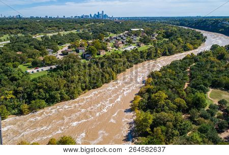 Aerial Drone View With Austin , Texas In The Background Skyline With Flooded Chocolate Milkshake Col