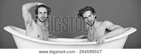 Gay Men Or Unshaven Macho Twins With Stylish Hair Sitting Naked, Sexy Muscular Torso In White Bath T