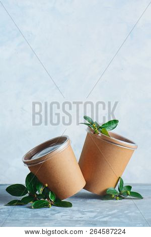 Craft Paper Eco-friendly Food Packaging With Cherries. Disposable Cups On A Neutral Gray Background