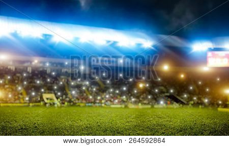 Football stadium, tribunes with fans, shiny lights