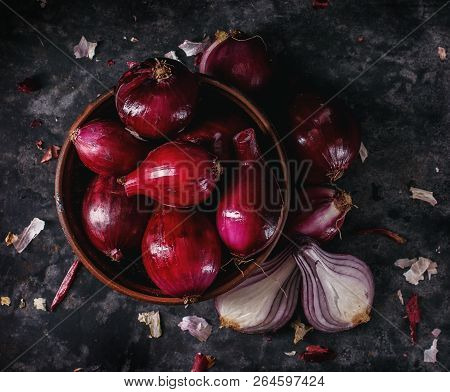 Onion With Husk. Plate With Red Onion.