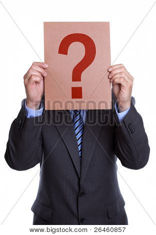 Businessman holding a question mark sign in front of his face on white background