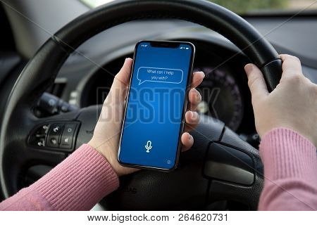Women Hands Holding Phone With App Personal Assistant On Screen In The Car