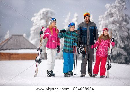 skiing -family enjoying in winter vacation in mountains at ski resort