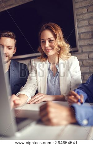 business, finances, economics and technology - business woman working on computer at creative office