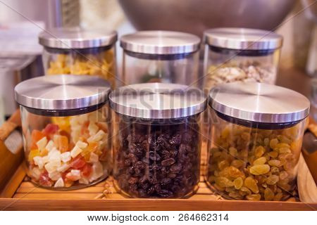 Sweet Colorful Glass Mugs, Jars Or Bottles On Display In Wooden Tray In Kitchen Or Pantry For Toppin