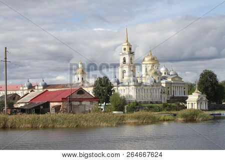 Orthodox Chirch And Church Buildings Near The Lake, Nilov Monastery Seen From Water In Russia, Selig