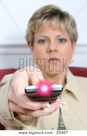 Woman Aiming Remote With Light On