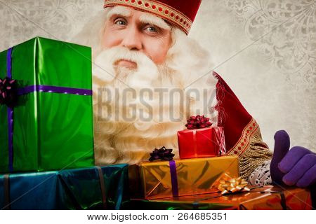 sinterklaas with gifts. Vintage Saint Nicholas in retro style with gifts. Dutch Santa Claus