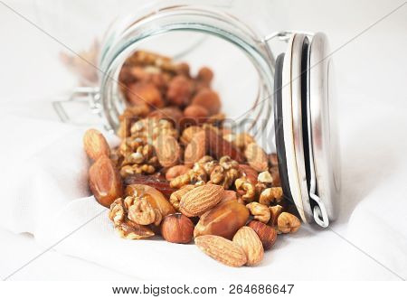 Glass Jar Of Mixed Nuts On White Background