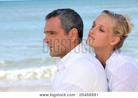 couple embracing on the beach