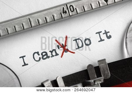 Can't crossed out to read I can do it concept for self belief, positive attitude and  motivation written on an old typewriter