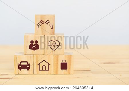 Insurance Concept, Wooden Cube Symbolize Put The Insurance To Protect Or Cover Person, Property ,lia