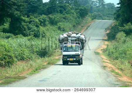 Donkorkrom, Ghana: July 20th 2016 - A Lorry Carrying Sacks Of Goods On A Country Road In Ghana, Look