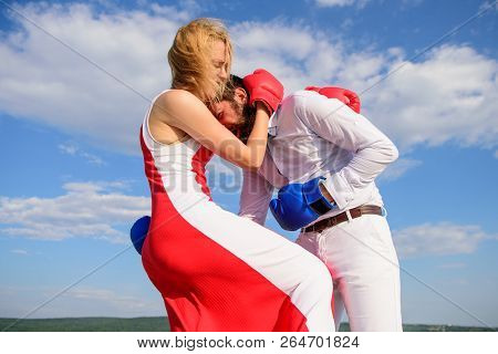 Man And Woman Boxing Gloves Fight Blue Sky Background. She Knows How To Defend Herself. Girl Confide