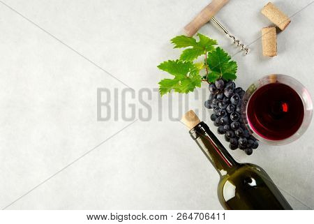 A Glass Of Red Wine And Grapes