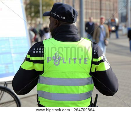 Dutch Police Officer In The Streets Of Amsterdam