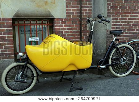 Big Wooden Shoe On A Transport Bicycle