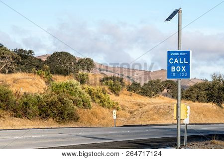 A Highway Call Box Along A Rural Roadside Serves To Help Drivers In An Emergency Situation