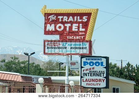 July 3 2017 - Lone Pine, California: Vintage Motel Sign For The Trails Motel In Downtown Lone Pine,