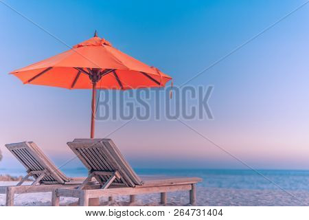 Tranquil Scenery, Relaxing Beach, Tropical Landscape With Chairs And Umbrella In Sunset. Summer Vaca