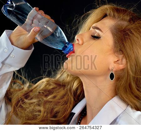 Hydration at Office. Sensitive teeth woman drinking cold water from bottle. Sudden toothache of thirsty girl in business suit drink. Medicated water to treat the body. poster