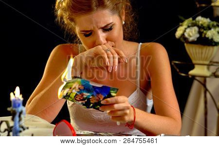 Burning photography kissing newlywed. Wedding memories. Broken heart woman. Couple break up. Sad bride on unhappy wedding. Relationships have not become fairy tale. Portrait crying female. Family has