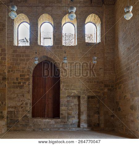 Public Mosque Attached To Al-muayyedi Bimaristan Historic Building, With Wooden Door And Bricks Ston