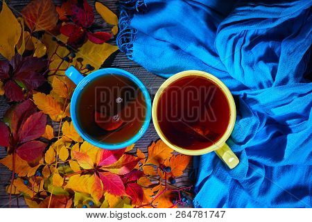 Autumn Leaves, Cups Of Tea And Blue Scarf, Top View