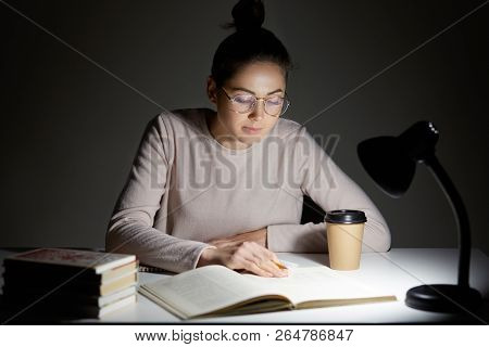 Busy Female Teenager Reads Book, Uses Table Lamp, Prepares For Final Examination, Sits At Desktop, W