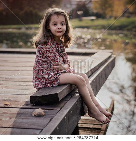 Sad crying girl on the countryside