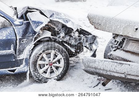 Crashed Cars Right After An Accident On Winter Road With Snow