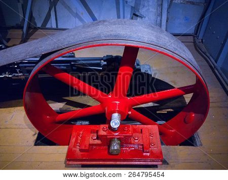 Wheel And Belt That Transfer Steam Generated Power To The Paddle Wheel Of A Riverboat Steamer.