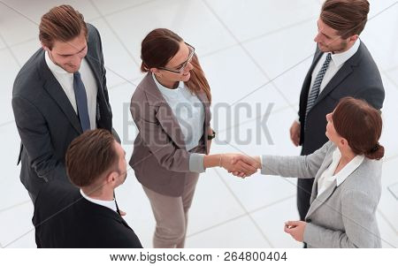 top view.handshake of two business women before the meeting.