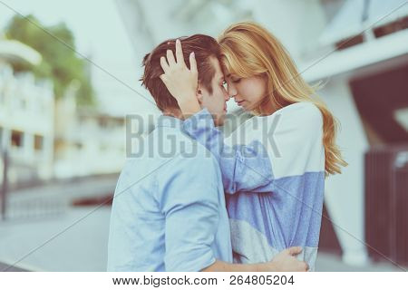 Beautiful Couple In Love Dating Outdoors And Smiling. Beautiful Girl Embraces The Guy