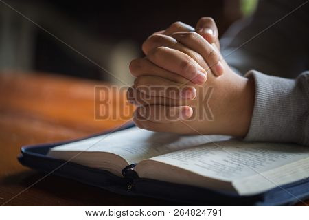 Close Up Woman Hand Praying  With Holy Bible, Woman Pray For God Blessing To Wishing Have A Better L