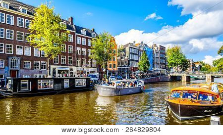 Amsterdam, The Netherlands - Sept 28, 2018: Tourist Canal Boats Mooring At Anne Frank House At The P