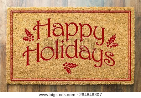 Happy Holidays Christmas Tad Welcome Mat On Wood Floor Background.