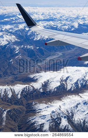Mountains In The Southern Alps In New Zealands South Island, Aerial View From Commercial Airplane