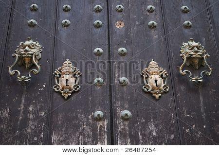 Colonial door with vintage locks and lion doorbell
