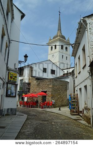 Picturesque, Narrow, Curved And Uphill Streets In Castropol With The Capanary Of The Church Of Santi