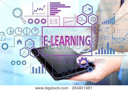 Business Education Concept. Businessman Click E-learning Button On His Tablet. E Learning Text Typog