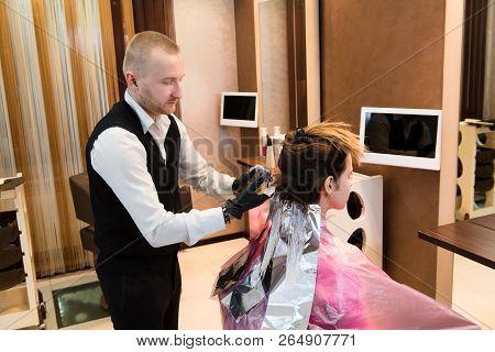 Professional Male Hairdresser Choose Hair Dye Color At Modern Salon, Female Customer Change Hair Col